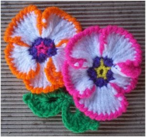 Stunning little and easy crocheted flower pansy applique motif with written pattern in PDF.